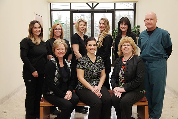 Photo of our Troy dentist and her team at Kristen Balutowicz DDS